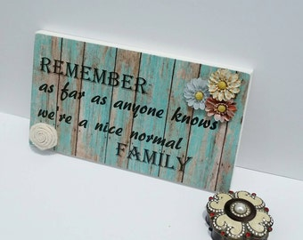 Remember as far as anyone knows we're a nice normal family, wooden sign, funny wooden sign, funny family sign