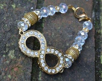 Infinity bracelet with rhinestones and beads