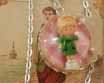 Polly pocket vintage 1991 necklace. Enclosed in a half glass orb, mounted on a vintage tarot card.