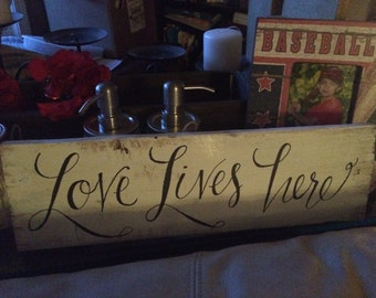love sign, Ivory wooden sign, love lives here with black paint writing WD1008