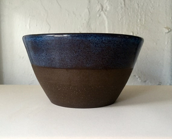 Modern ceramic black clay bowls in blue.