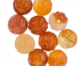 Carved carnelian beads in a floral design. Measures 10mm. Package of 6. b4-car315(e)