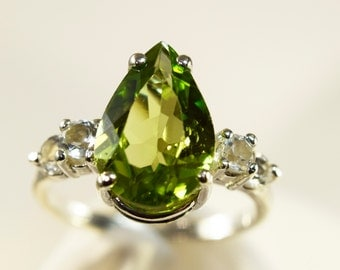 Beautiful Sterling Silver 3.5 + carat Pear Shaped Peridot Ring with Double Accent Stones