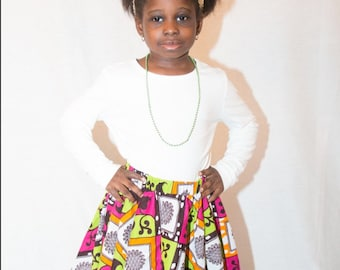 Esty Ankare African kids flear skirt with two pocket and a marching heir tie