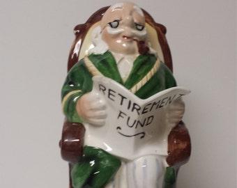 "Pipe Smoking, White Haired Gentleman in Rocking Chair; ""Retirement Fund"" Bank; Lefton, Japan"