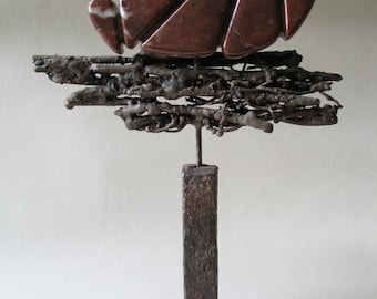 MAKE A C...   Brown marble and steel sculpture
