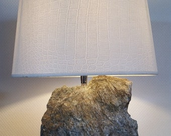 Table lamp with natural stone foot.