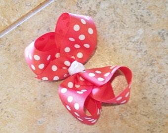 Coral and white polka dot bow