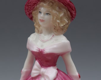 Porcelain Figurine Endless Love by COALPORT BONE CHINA is a beautifully romantic figurine from their Valentine Debutantes Collection