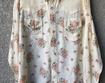 Cream colored floral semi sheer snap up blouse