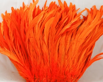 "Orange 10"" - 12"" strung coque rooster tail  feathers"