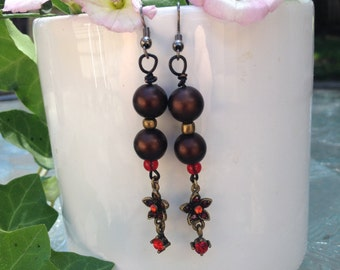 Brown Dangle earrings with red accents