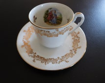 """Four Limoges """"Fete Galante"""" Watteau or Fragonard style cups and saucers."""