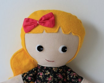 Girl rag doll with ponytail. Blond hair with flower top.