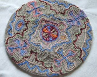 crocheted and embroidered beret