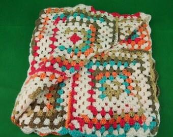 Multi coloured baby rug