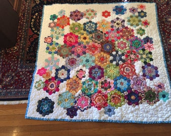 Hand quilted throw sized fussy cut hexagon quilt--flowers!