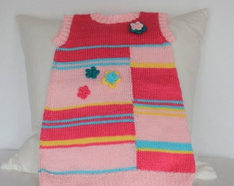 knitted children dress for girls in pink and rose shades, fresh summery, with crochet flowers in various colors