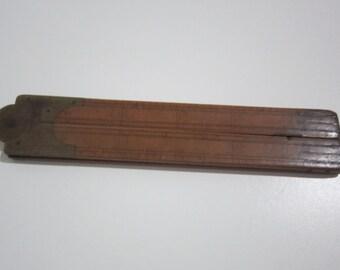 """Vintage 24"""" wooden folding ruler"""