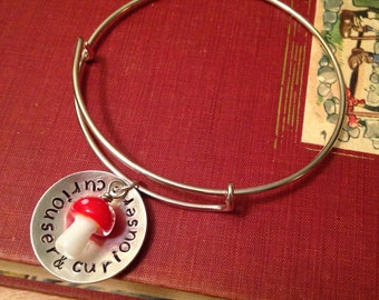 "Alice in Wonderland inspired ""curiouser & curiouser"" hand stamped bangle on expandable bracelet."