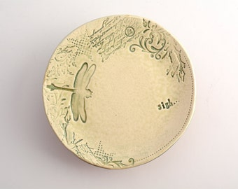 small plate/saucer with sigh and dragonfly stamps