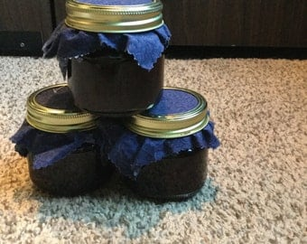 Black plum and blueberry jam in a sealed 8 ounce jar, homemade