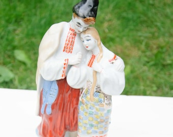 China Statuette Depicting a Guy and Girl Wearing Ukrainian National Clothes. Hand-Painted.