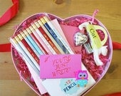 Valentine Heart Gift Set with Pencils, pen, notebooks, erasers, sharpener, chocolate and card. Romantic and fun gift.