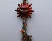 Sun Key Pendant -- Red/Orange Blazing Sun Face Wire Wrapped Key Pendant, Antique Brass Wire, Fire Opal Spark Swarovski Crystals