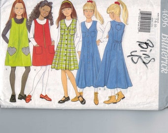 1990s Girls Sewing Pattern Butterick 4696 Girls Easy Jumper Dress Flared with Heart Pockets Top Size 7 8 10 Breast 26 27 28 29 UNCUT 1996 99