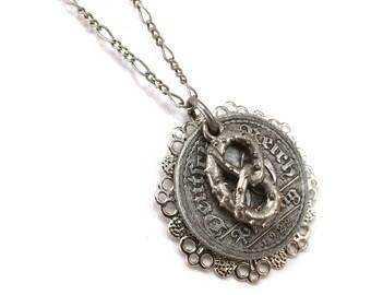 German pfennig coin necklace with pretzel charm