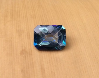 Loose Mystic Topaz - 7x9mm Emerald cut Mystic Blue Topaz with Checkerboard Top weighing 2.71 carats - LSG684