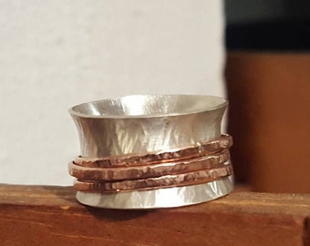 Textured sterling silver spinner ring with rose gold filled bands