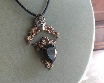 Aged brass skull black crystal halloween inspired necklace