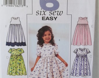 Girl's Sewing Pattern Butterick 3762, Easy to Sew Flared Dress with Neck and Sleeve Ruffles Party or Special Occasion Dress UNCUT Size 2 - 5