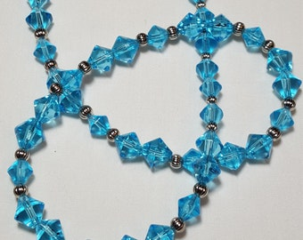 Necklace, pretty blue faceted glass beads in various sizes, with heart clasp, silver tone, silve color spacer beads