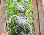 Patina Garden Robot Sculpture in Grass Art Postcard