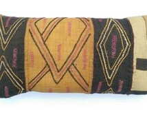 Bolster cushion made from African handwoven raffia fabric