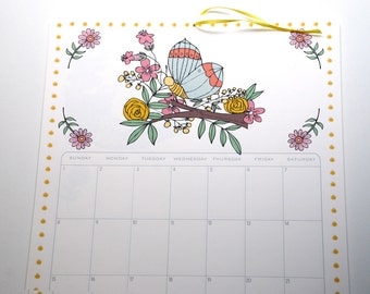 2017 Wall Calendar, Size 11x17 Inches featuring 12 different illustrations in green, pink, yellow, coral, brown and aqua