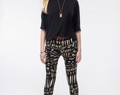 Hawk Wing Leggings in Gold and White on Black