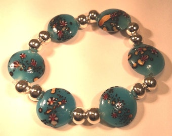 Turquoise lampwork glass bead stretch bracelet with silver embellishments