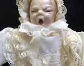 Grumpy baby porcelain doll