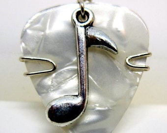 Classy white guitar pick with silver music note charm