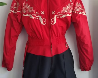 WINTER SPORT SZ 12: Bogner women one piece ski suit in red and black with beautiful beige suede accents and embroidery details