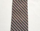 Vintage 1960s Grey, Orange, and White Diagonal Stripe Polyester Tie Necktie