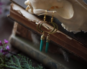 brass moon earrings with turquoise howlite spikes