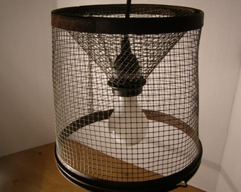 Industrial Pendant Light Fixture. Rusted Galvanized metal Minnow Basket made of Wire Mesh construction.