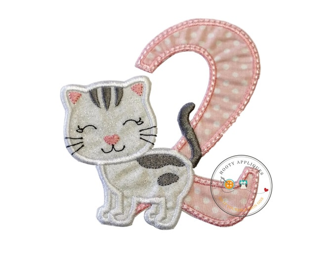 Girl's second birthday iron-on kitty applique with white glitter fabric trimmed in white, light pink white polka dot print trimmed in pink