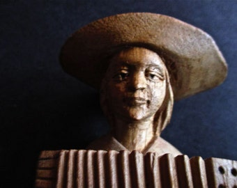Old Carving Of Mexican Indian Boy Musician Playing Acordion