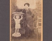 Amusing CDV of a Woman Posing Next to a Large Statue